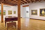 A gallery exhibiting work by members of the Taos Society of Artists at the Harwood Museum of Art in Taos, New Mexico