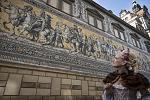 """Fürstenzug"", the famous mural with the procession of the princes and a lady with historic baroque costume.  Photo: © Sven Döring for Dresden..."
