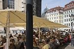 "Outdoor dining on Neumarkt Square in Dresden in front of the Frauenkirche; with view to the golden ""Fama"" sculpture on the dome of the art academy...."
