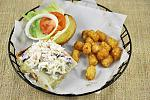 Drunken Mermaid Fish Sandwich: Grilled and marinated fish filet fresh from local waters covered in our signature slaw, remoulade and melted provolone.