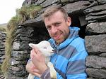 Aedán will show you around the farm when you visit 'Hold a baby lamb' - and you might even get a chance to bottle feed a lamb!