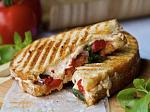 Blue Peacock Bistro offers fresh panini sandwiches and state of the art wine dispenser for the perfect combination
