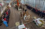 Captain and crew stand at attention on board a Tall Ship  photo credit: Sail Training International