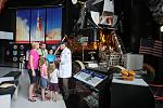 A family visiting with a Docent in the Saturn V Hall