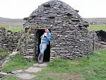 Hold a Baby Lamb and Beehive Stone Huts, Dingle Peninsula, County Kerry, Ireland