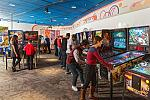 Guests playing classic pinball cabinets in the Pinball Playfields exhibit.