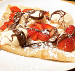 Delice Crepes, at the Hukilau Marketplace! These delicious crepes are French pancakes made of a thin batter, topped and filled with a variety of...