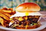 HAWAIIAN BURGER! A local favorite, stacked with grilled sweet pineapple, Pupukea Garden greens, onions and topped with an egg, all on a brioche bun!...