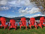 Signature Red ADK chairs along the water's edge