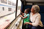 Grandma and grandchild enjoying a ride on an Amtrak train.