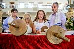 Rabbi Barbara Aiello's student  Emma B reads directly from the Torah scroll as her family looks on. Emma's ceremony was the first Bat Mitzvah of its...