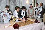 Tyler W. reads from an ancient Torah scroll (1783) at Sinagoga Ner Tamid del Sud - as Rabbi Barbara celebrates the first public Bar Mitzvah ceremony...