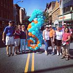Tour Guests during Enchanted City by seahorse balloon sculpture in Troy