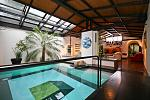 "Swimming pool in the living room of the Botanical Garden apartment in Trastevere. The apartment was renovated by the renowned architect ""Partrizio..."