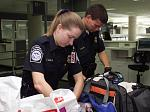 CBP officers inspect the baggage of arriving air passengers.