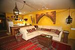 The Marrakech suite in the Ashland Creek Inn.  The archway above the sofa came from a 200 year old palace in Morocco.  The furnishings for this room...