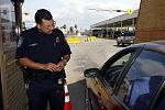 A CBP officer processes a traveler as the cross the border from Mexico.