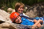 Two young rafters enjoy a rest in a hammock at our private river side landing.