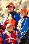 A family anxiously awaits the start of their whitewater raft trip on Bighorn Sheep Canyon with Echo Canyon River Expeditions.