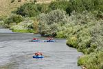 An group of Echo Canyon rafts drifts gently on the Family Float rafting trip.