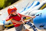 A young girls helps pull her crews raft ashore on an Echo Canyon raft trip.