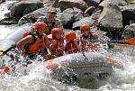 A family and guide enjoy the whitewater on Bighorn Sheep Canyon