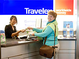 Travel Expert Stephanie Abrams at a Travelex kiosk in San Francisco International Airport
