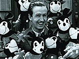 Walt Disney in the early 1930s surrounded by some of the early Mickey Mouse dolls. Photo courtesy The Walt Disney Company, ©Disney.