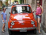 Admiring a cute 500 Fiat on Via Marghera, Italy