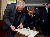 Canon Stephen Neill shows President Obama the church records from Templeharry Church on the occassion of the visit of the President and First Lady to Moneygall - May 23 2011 (Official White Ho