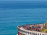 Pros battle on the coast of California during the Amgen Tour of California race with Trek Travel cycling vacations.