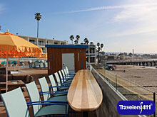 The newly expanded and resurfaced beachfront pool deck with beach access features four outdoor showers, an oversized hot tub and year-round poolside bar with waterfront views. Dream Inn, Santa